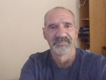 vágyakozó 54 éves társkereső profilképe